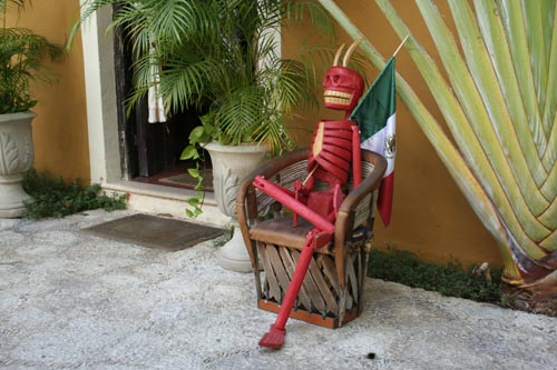 image of red skeleton in a chair